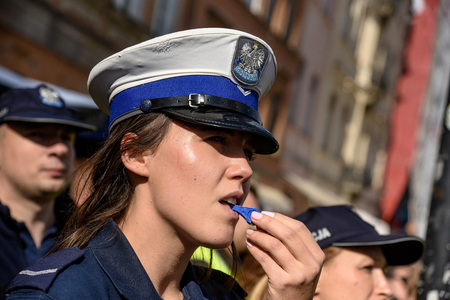Warsaw / Poland - October.02.2018: Demonstration, national protest of police officers for fair work wages. Police woman portrait blowing in the whistle. Editorial