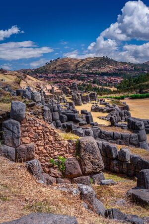 Sacsayhuaman ruins in Cusco, Peru. A monumental complex of stone buildings made by Incas. Pre Columbian megalithic fortified constructions often visited by tourists.