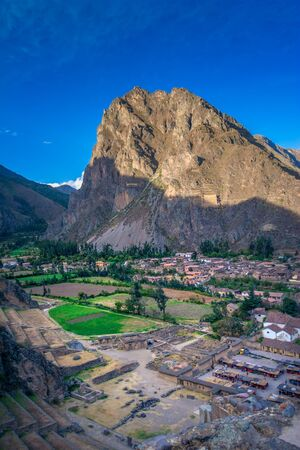 Ollantaytambo - Incan ruins and gateway to Machu Picchu in Peru. View on the archaeological site in Sacred Valley. Fortress build by peruvian king Pachacutec.  Viracocha mountain. Stock fotó