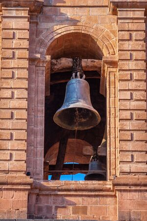 Old bell under the arch of the city Cathedral in Cusco  Cuzco, Peru.