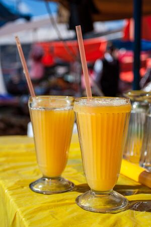 Two glasses of delicious, refreshing freshly made by local people in the street stand, orange juice. Tasty beverage. Stock fotó