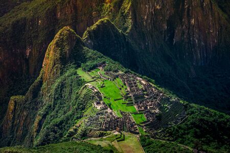 Unique aerial view on the Machu Picchu  Huayna Picchu mountain with Incan sacred city ruins during the sunset. Stock fotó