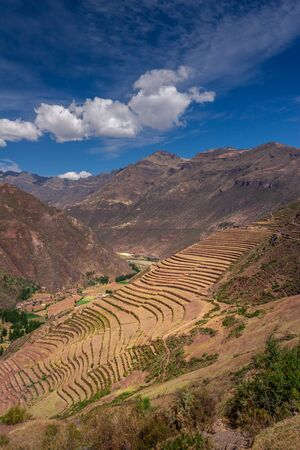 Terraced fields in the Inca archeological area of Pisac in the Sacred Valley near the Cusco city in Peru. Agricultural terraces on the steep hillside. Beautiful landscape and tourist destination.