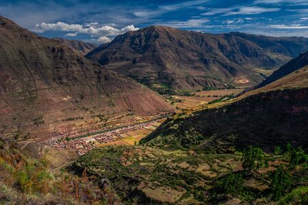 Spectacular view on the Sacred Valley near by the Cusco  Cuzco city in Peru. Enormous Andes mountains and the small villages in the canyon.
