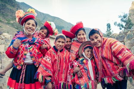 Ollantaytambo  Peru - May 29.2008: Group of children dressed up in the traditional, colorful peruvian costumes, smiling and posing for the picture.