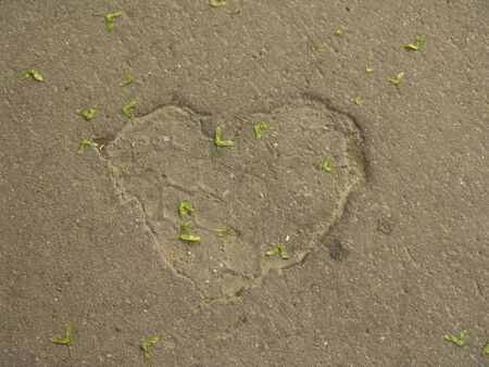 Heart shape engraved on a concrete street