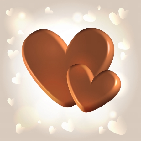 Chocolate couple of hearts for Valentines day over glistening warm background Stock Photo
