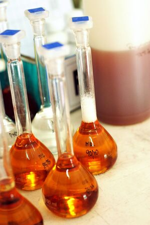 Beakers with chemical content in a lab.