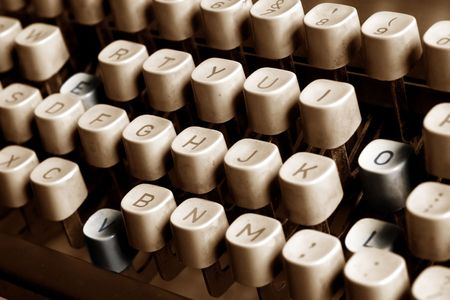 Four keys pressed down from a vintage typewriter. The letters form the word: LOVE. the four Keys are tinted in a different color to make thme stand out. Intentional slight selective focusing. Stock Photo