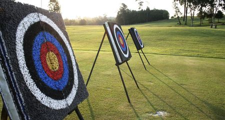 Target boards at an archery range. Can be use as a metaphors in sales marketing about reaching sales target, etc. Stock Photo