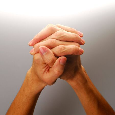Body parts - Clasped hands in position of prayer, concept for hoping, etc.