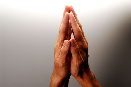 Hands in action - Clasped hands in position of prayer considering, etc. concept for hoping, thinking, decision, etc.
