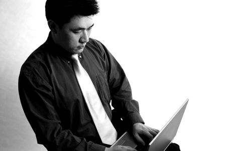 Confident Young Asian Business Man  Entrepreneur working on his laptop computer. Isolated on white.