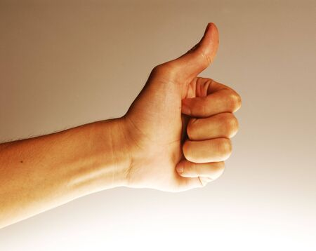 Hands in action - Thumbs up. Concept for satisfaction, excellence, etc. Stock Photo