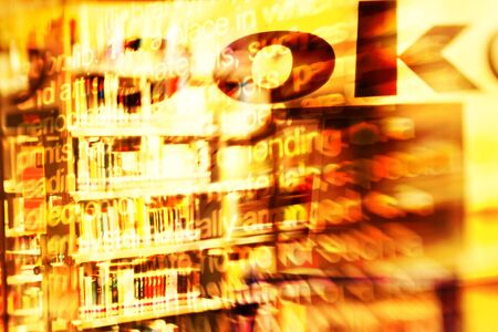 special effect: Abstract composition with Colorful books on a public library shelves. shot with a special effect lens. Combined with typography and texts.