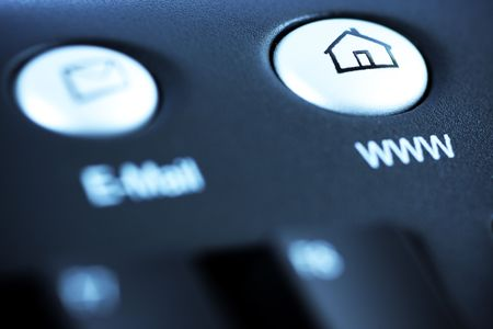 Toned moodshot of home page or website media shortcut button - intentional selective focus on homepage button.  Stock Photo