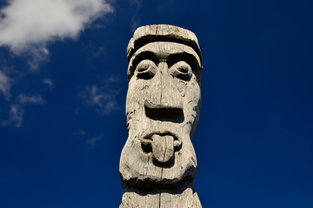 Pagan idol with an outstretched tongue