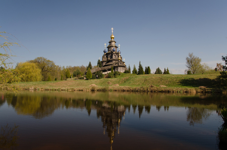 A wooden russian orthodox church on a lake