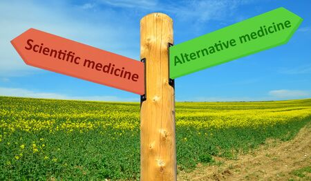 Road sign with the inscription alternative and scientific medicine Stock Photo