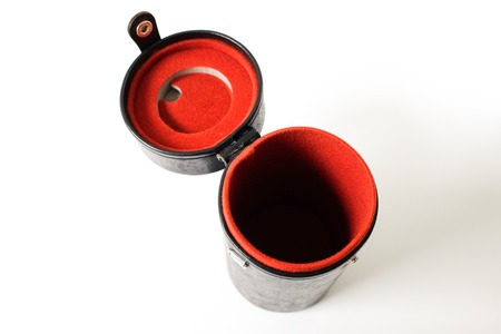 A lens case with red interior padding against white background Stockfoto