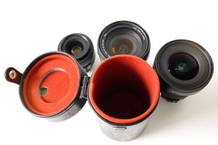 a Lens box with three lenses against white background Stock Photo