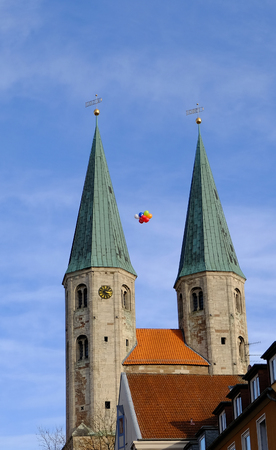 The towers of the Church of St. Martini in Brunswick with colorful balloons