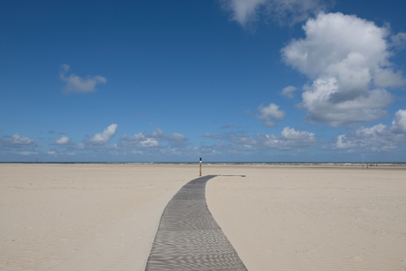 A wooden path to the sea on the beach on Norderney