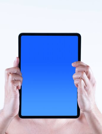 A man holds a tablet in front of his face against a white background