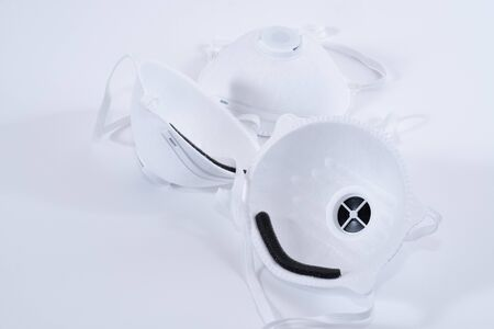 Three fine dust respirators to protect against pathogens over white background Standard-Bild