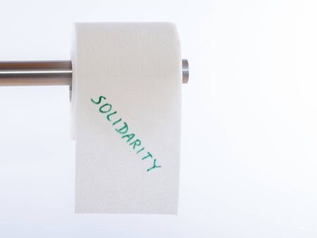 Detail of a toilet paper roll over white background labeled