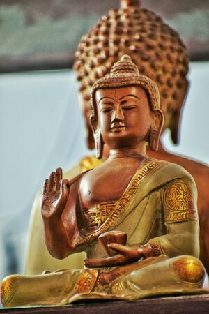 back to back idol of lord buddha stock photo picture and royalty