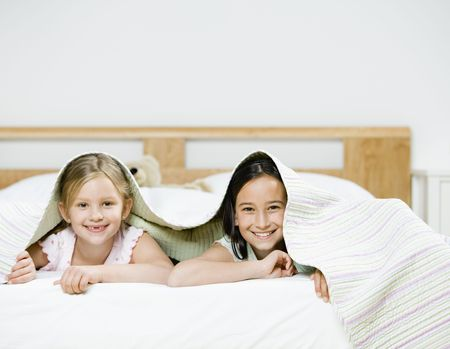 bed sheet: Portrait of Young Girls under Bed Sheets