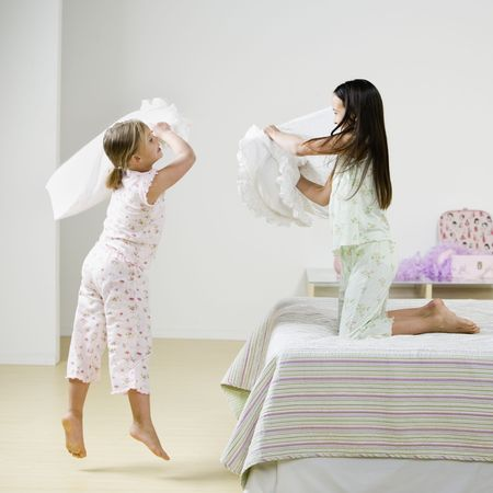 cushion: Young Girls Pillow Fighting