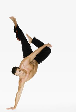 demonstrating: young man demonstrating hand stand