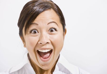 Asian woman surprised with open mouth. Horizontally framed.