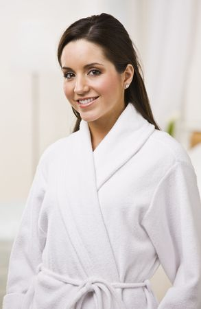 Attractive brunette female in white bathrobe. Vertically framed shot. Stock Photo - 5120505