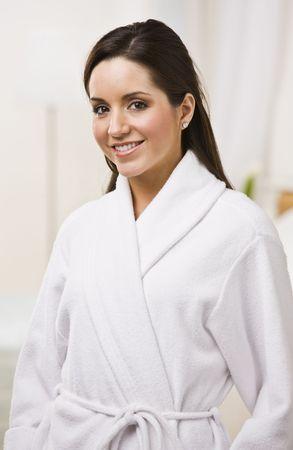 Attractive brunette female in white bathrobe. Vertically framed shot. Stock Photo - 5120505