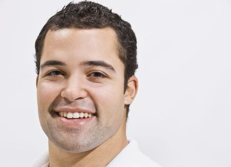Attractive male head shot with smile. horizontal