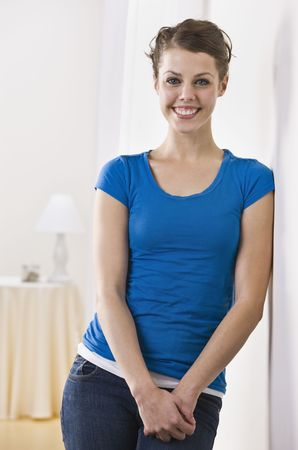 An attractive young female smiling directly at the camera.  Vertically framed photo. Stock Photo - 5120625