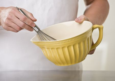 Man using whisk and mixing bowl. Horizontal photo