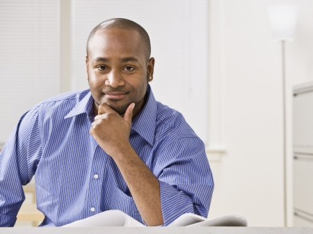 A young businessman is smiling at the camera.  Horizontally framed shot. Stock Photo - 5334047