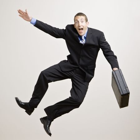 sales person: Business man jumping in the air and clicking heels. Square format. Stock Photo