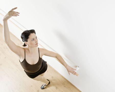 Woman dancing in dance studio. Horizontally framed shot. Stock Photo