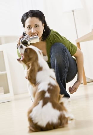 Woman filming dog with video camera. Vertically framed shot. Stock Photo - 6394430