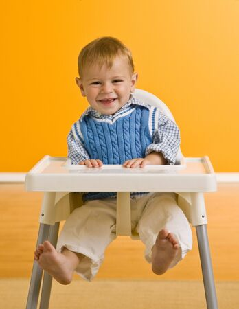 Young boy in highchair photo