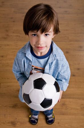 Boy holding soccer ball photo