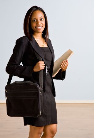 african business: African businesswoman with briefcase