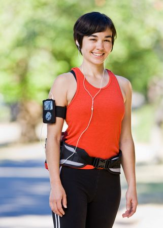 athletic wear: Woman wearing hip pack and mp3 player