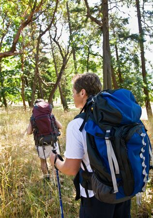 tramping: Couple hiking with backpacks Stock Photo