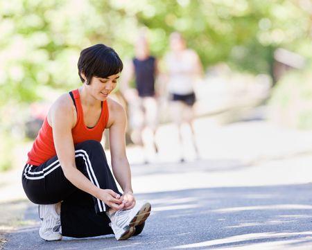 tying: Runner tying shoes